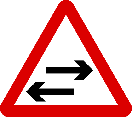 Two-way traffic crosses a one-way road
